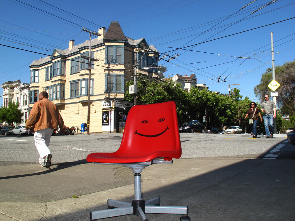 Smiley Face On An Office Chair At The Fourway Crossroads