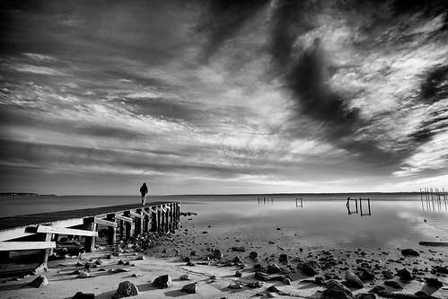 winter sunset blackandwhite bw usa white black beach water monochrome clouds digital 35mm bay rocks florida cloudy sony voigtlander gray wide january wideangle super fullframe alpha 15mm a7 heliar 2014 mirrorless floridatown monochromefx 7ilce7