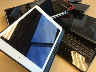 Tablets stacked | by IntelFreePress