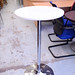 Tall white circular table