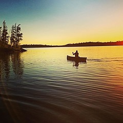 Sunset paddle.  Photo by Justine Anderson.  #gunflinttrail #bearskinoutfitters #bearskinlodge