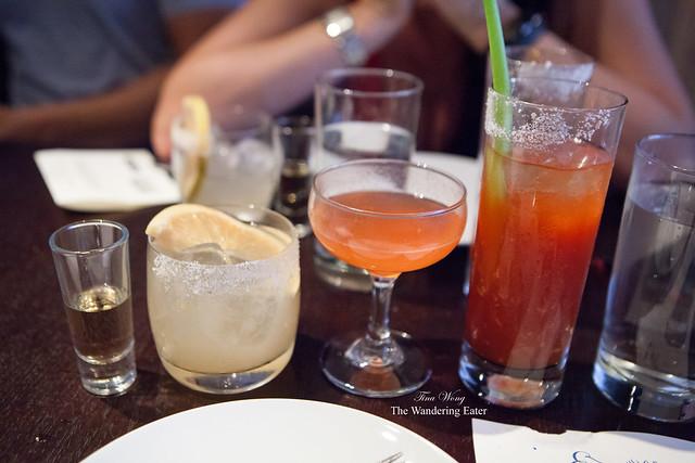 The entire lineup of drinks: Olmeca Alto Reposado shot, Breakfast Margarita, Siesta, and Bloody Maria