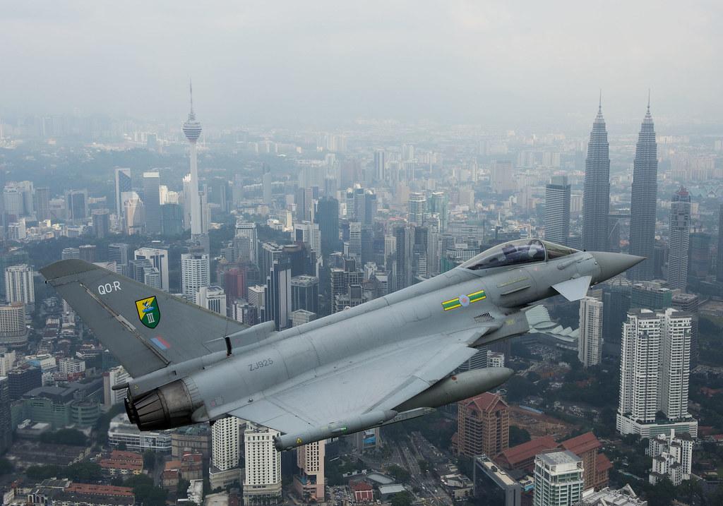 RAF 3 (F) Squadron Eurofighter Typhoon over the Petronas towers in Kuala Lumpur, Malaysia.