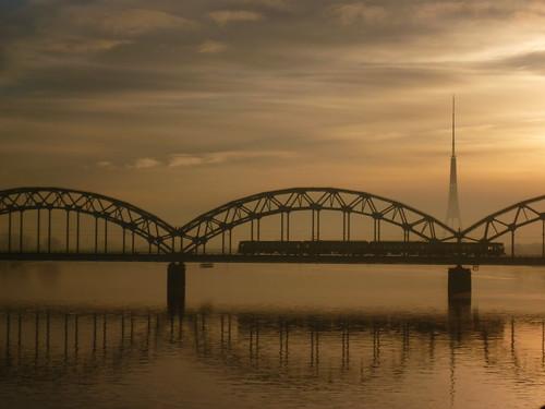 bridge sunset train river latvia riga daugava