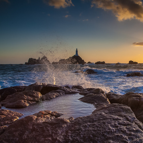 sunset sea lighthouse seascape water landscape droplets rocks waves dusk jersey vista splash corbiere leadinglines
