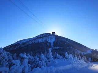 The sun eclipsed by Jay Peak summit