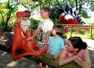 Kids play with dinosaur