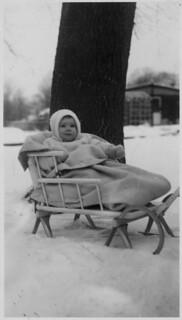 Ann MacDonald in a sled at Prescott / Ann MacDonald dans une luge à Prescott
