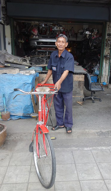 man with a red bicycle