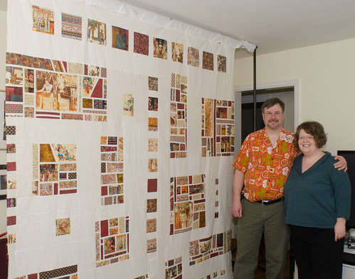 My neighbor Mary offered to take a photo of us with the finished top.  The finished quilt, and the story behind it, can be seen at domesticat.net/quilts/cairo-sunset