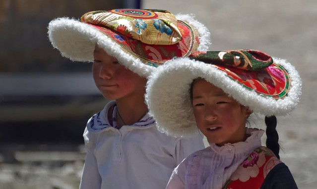 "Girls wearing the traditional ""Flat Hat"" of lambskin, Tibet 2014"
