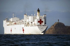 In this file photo, USNS Mercy (T-AH 19) sits off the coast of Dili during a previous Pacific Partnership mission. (U.S. Navy/MC2 Joseph Seavey)