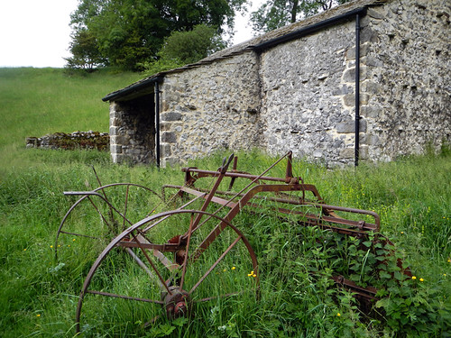 Old farming implements and a stone barn on our Malham walk in the Yorkshire Dales of England