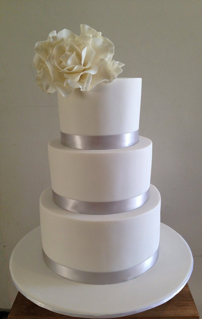 3 tier white simple wedding cake with sugar roses