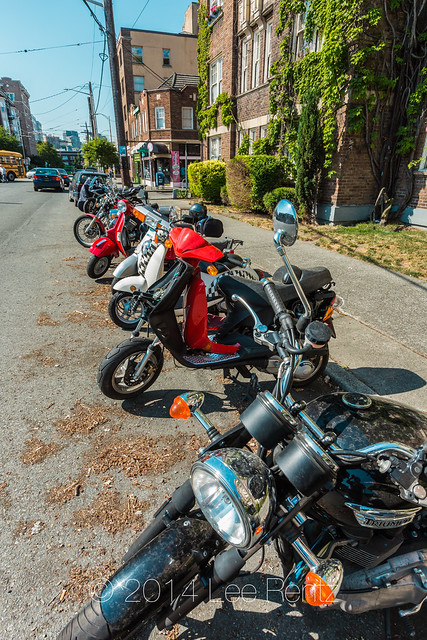 Scooters and Motorcycles Parked in Seattle