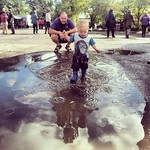 George and Mark having fun in muddy puddles at Gilwell Reunion