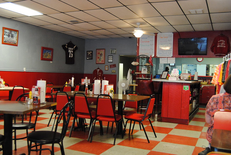 The back half of the restaurant features a lunch counter and what looks like a place where apparel is being sold.