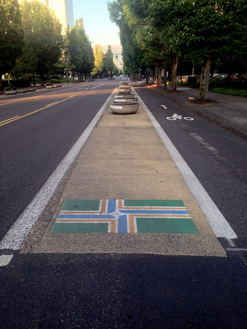 Portland flag in bike path separation