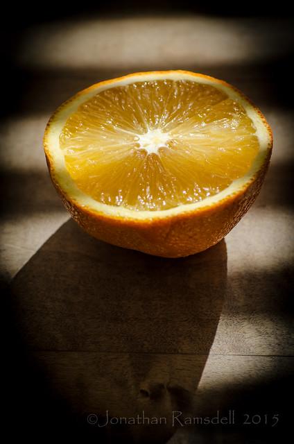 Orange & Shadows on Kitchen Table