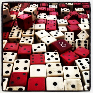 I would buy a shipping container half filled with old, worn-down dice and build a house inside that container with those dice. I would.