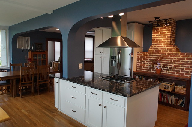 AFTER- Close-up of the kitchen island and the brick chimney. Note the custom bookcase in front of the brick chimney. We built this bookcase on site and use the old fireplace mantle as the bookcase countertop.