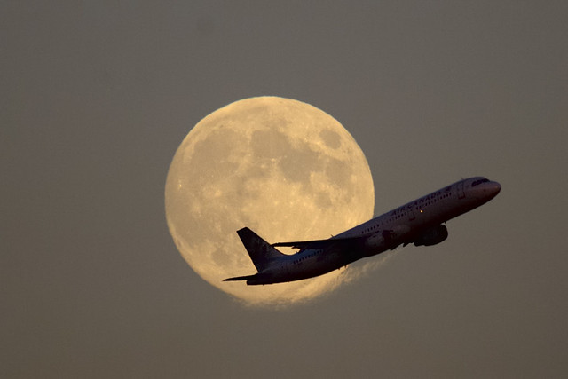 Air Canada Airbus climbing out in front of full Harvest Moon - Toronto Pearson ..