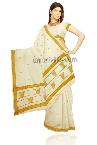 Kerala Style Carpenter Works And Designs September 2013: This Lovely Cream Color Pure
