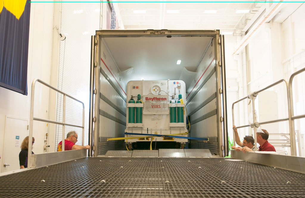 The Visible Infrared Imaging Radiometer Suite (VIIRS) is carefully unloaded from its traveling container
