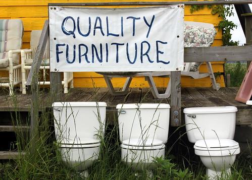 sign three row toilets pickers