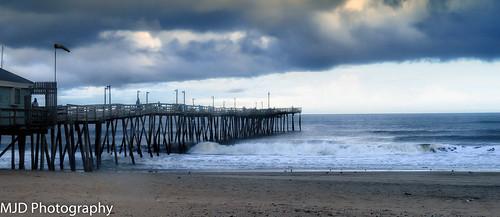 ocean sea sky beach clouds pier sand waves outerbanks
