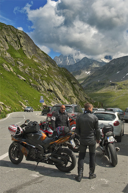 Motorcyclists in Saint Bernard Pass Nord . In the back ground; The Mountain of Grand Combin. August 16, 2013. No. 7858.