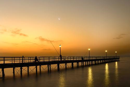 sea moon seascape sunrise reflections dawn pier seaside fishing fisherman nikon day fishermen cyprus moonrise d800 limassol 247028 goldlight 2470f28 φεγγάρι ανατολή αποβάθρα nikon247028 seapier κυπροσ enaerios fishingonpier limassolpier εναέριοσ charlescharalambous copyrightcharlescharalambousallrightsreserved pwpartlycloudy αποβάθραεναέριου φεγγάριεναέριοσ