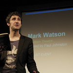 Mark Watson reads to the audience in 2008 |