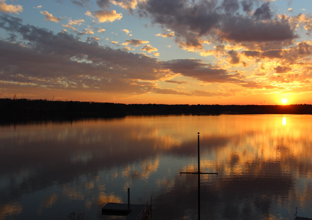 Reflections of sunset over Lake Crabtree
