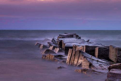 blue sunset ohio mist beach water rock wall nikon lakeerie purple unitedstates greatlakes splash tamron huntingtonbeach bayvillage breakwall d800wet