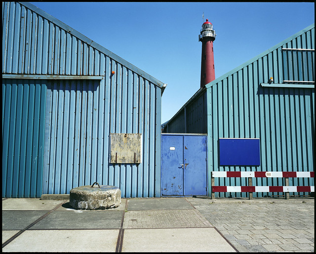 concrete, corrugated iron and a lighthouse