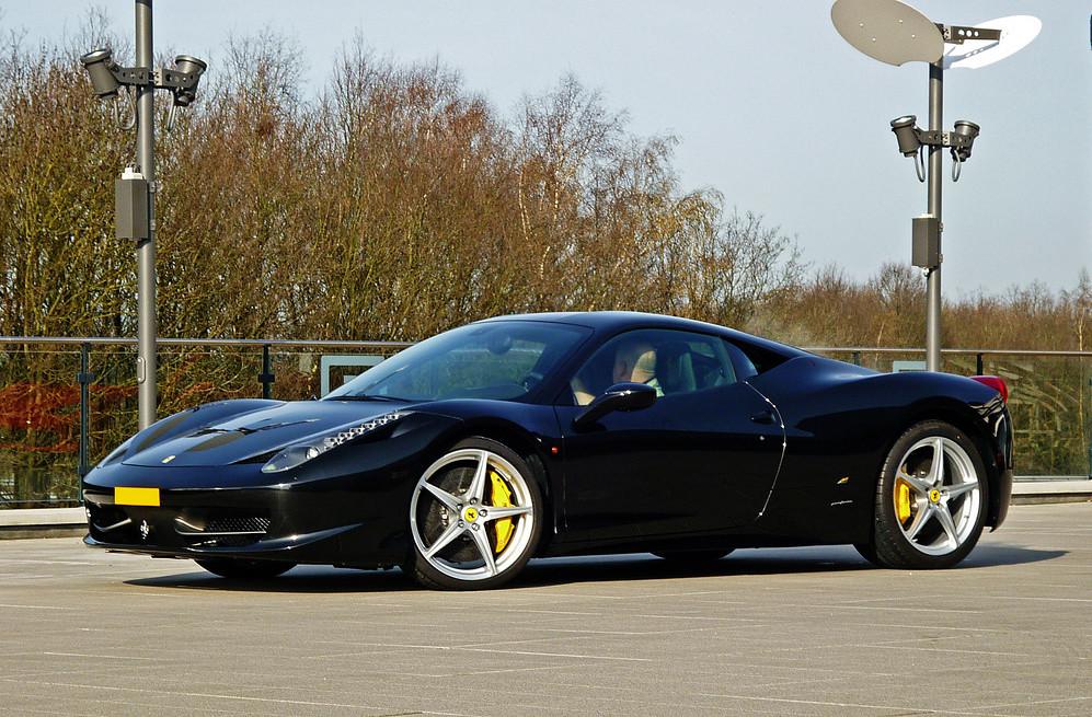 black Ferrari 458 Italia yellow brake calipers