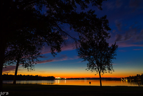 sunset summer lake water orange sky blue twilight trees landscape