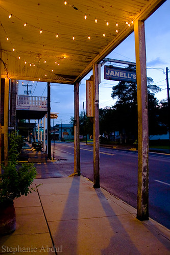 old bridge sunset yellow shop night lights evening town louisiana purple antique south small country twinkle southern cajun janelles breaux