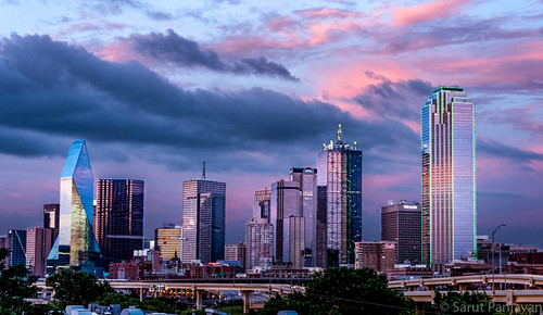 red urban downtown dallas sunset bronze clouds sky public