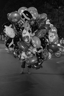 fly away- balloon vendor | by nubianomad