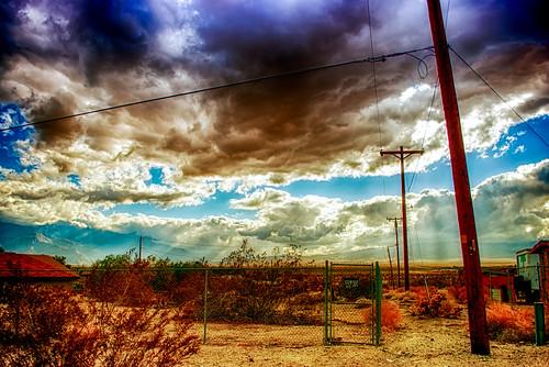california sky usa mountains rain clouds fence landscape sand nikon rocks desert coachellavalley repetition d200 telephonepoles liquid hdr crepuscularrays deserthotsprings crepuscular riversidecounty flickrfriday ourdailychallenge fencedfriday hbmike2000