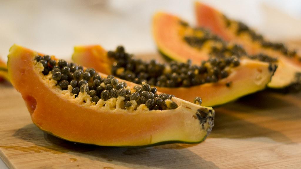 Papaya | Cut papaya on a cutting board. If you use this imag… | Flickr