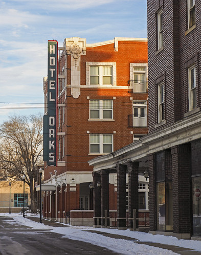 winter light sunset snow cold castle beautiful vintage hotel evening tv neon glow unitedstates walk wroughtiron royal freezing olympus mo missouri porch glowing oaks deco excelsiorsprings 2014 em1 porches royalhotel oldsigns crownroom fotoedge hoteloaks steelsigns omdem1