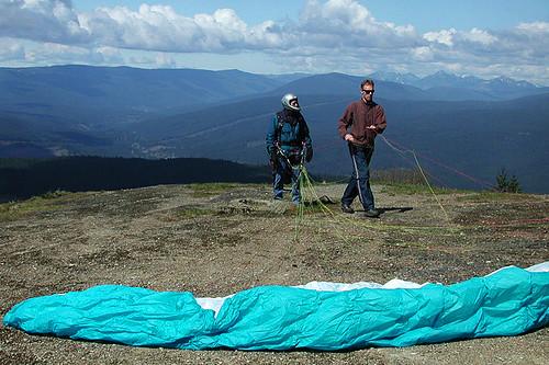 Paragliding instructor Jayson Biggins atop Mount Prevost in Duncan on Vancouver Island, British Columbia, Canada