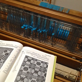Threading the loom in turquoise - front view | by akari.eiri