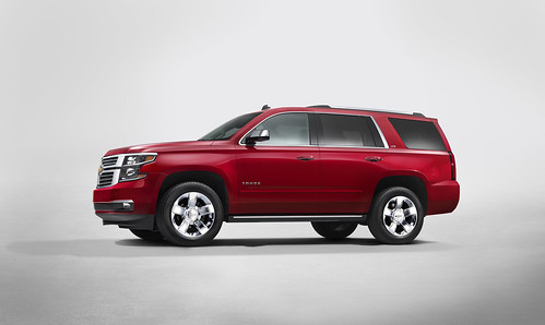 2015 Chevrolet Tahoe in Crystal Claret side view from New York Reveal Photo