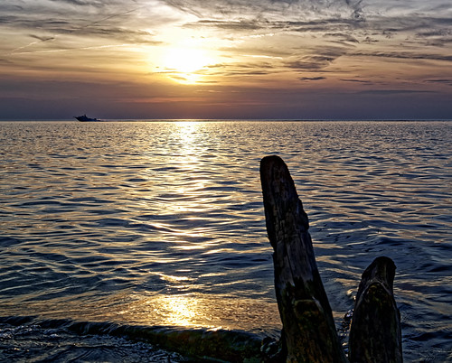 blue sunset sea sky sun lake water rock boat lakeerie outdoor dusk driftwood shore serene tranquil