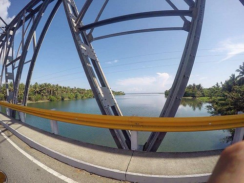 rider sand river clouds bridge bluesky province island tropical philippines ibajayaklan