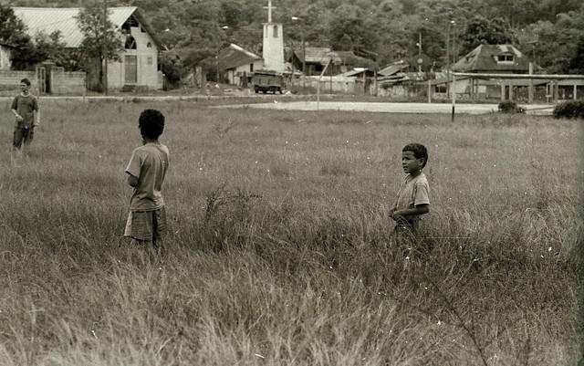 boys in a field near bosque nublado; Ecuador (1997)
